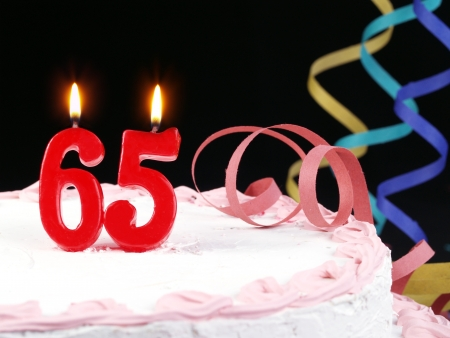Birthday cake with red candles showing Nr  65 photo