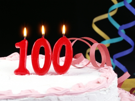 Birthday cake with red candles showing Nr  100 Stock Photo