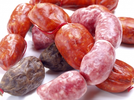 porc: Assortment of snack size sausages with red spicy sausages, black onion sausages and white meat sausages. Tipical size for Spanish Tapas. Stock Photo