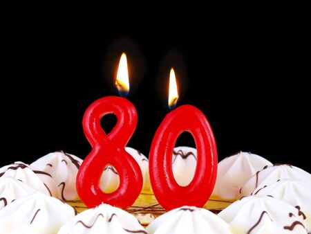 80: Birthday cake with red candles showing Nr. 80