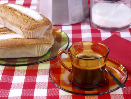 Traditional  vintage  spanish homemade breakfast. A cup of black coffee with a muffin. photo