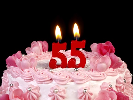 Birthday cake with red candles showing Nr. 55