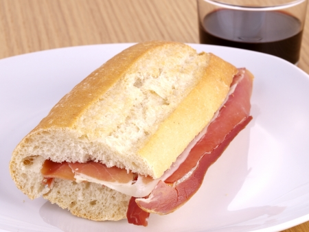 spanish culture: Cured ham Sandwich. Typical spanish sandwich made with cured ham and baguette bread.
