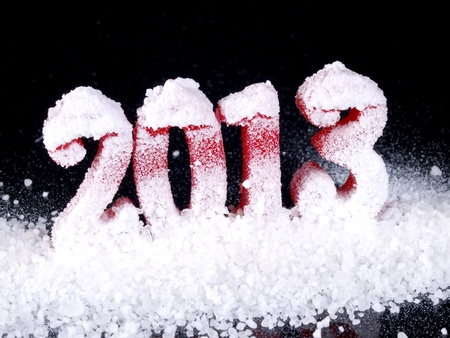 Frozen New Year 2013  Concept. Red numbers covered by snow on black background. photo