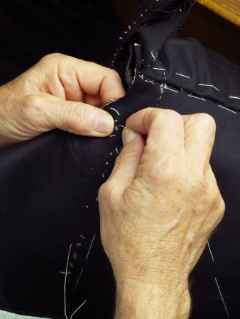 Tailor hands working, in a traditional way. photo