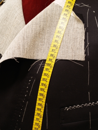 tailor measure: Tailor mannequin with an unfinished coat.