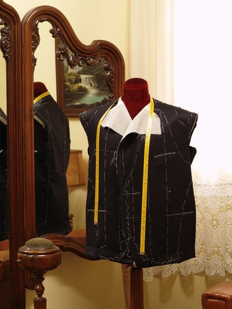 made to measure: Tailor mannequin with an unfinished coat.