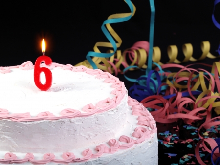 number six: Birthday cake with red candles showing No. 6 Stock Photo