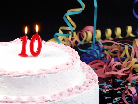 number 10: Birthday cake with red candles showing No. 10 Stock Photo