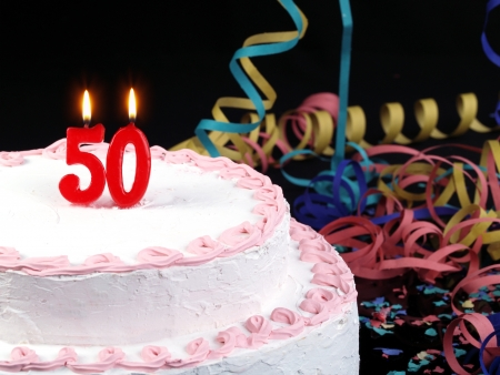 Birthday cake with red candles showing No. 50