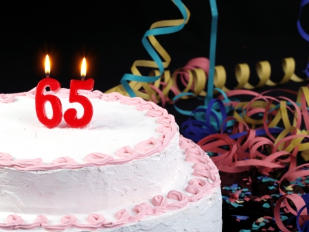 Birthday cake with red candles showing Nr  65
