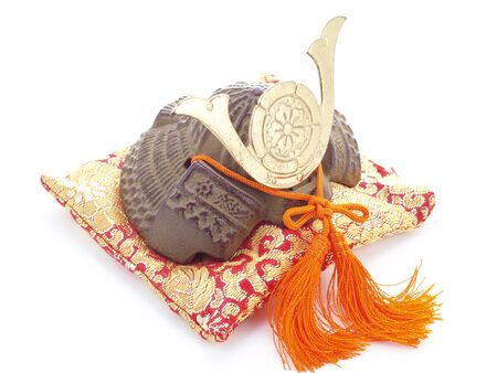 Japanese souvenir  Miniature of a samurai helmet on a pillow   photo