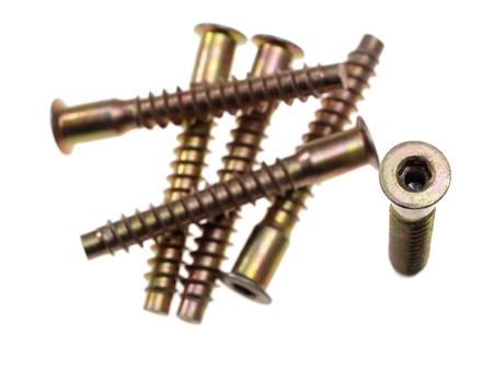 screw key: Socket hex head screws  Focus on head of vertical screw  High key background