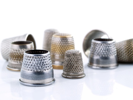 tailor shop: Sewing tools: assorted thimbles.  Stock Photo