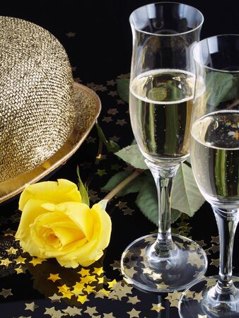 Yellow rose and champagne for a seduction evening. photo