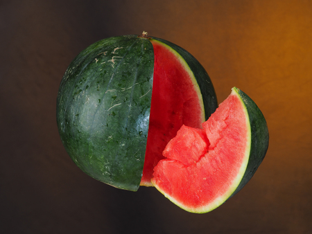 Watermelon – Sandía Watermelon and a slice suspended in the air.