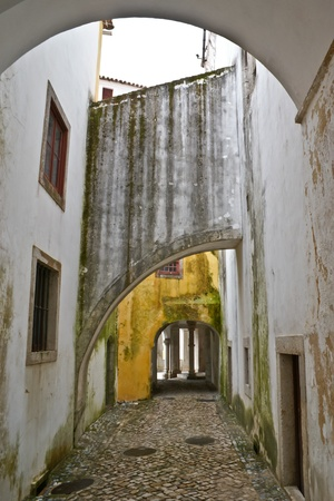 moresque: The old buildings often have interesting architecture details such as many different arches in courtyard of Sintra National Palace, Portugal