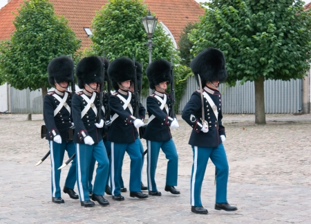 The Royal Life Guards provide a permanent guard at the Amalienborg Palace, the residence of Danish monarchy Stock Photo - 19044849