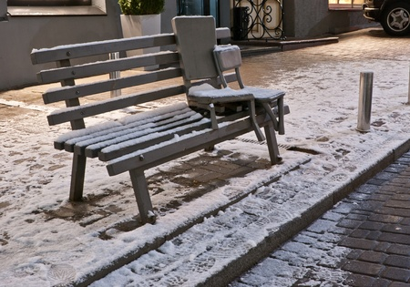 the couple of two small chairs come to sit on the bench in the winter evening, kiev ukraine  Isn photo