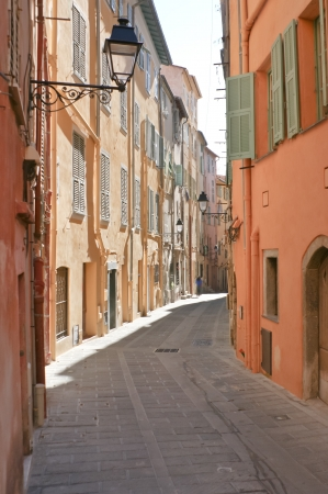 if you walk in mediterranean towns possibly you will find such narrow winding streets, like this located in menton, provence-alpes-côte d photo