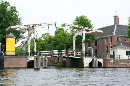 amstel: the white drawbridge on the amstel river, amsterdam