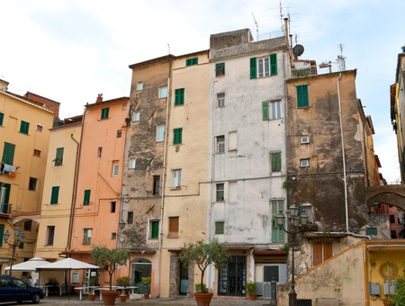 sanremo: these high tilted  houses with cracked paint on the frontage look great, Sanremo, Italy