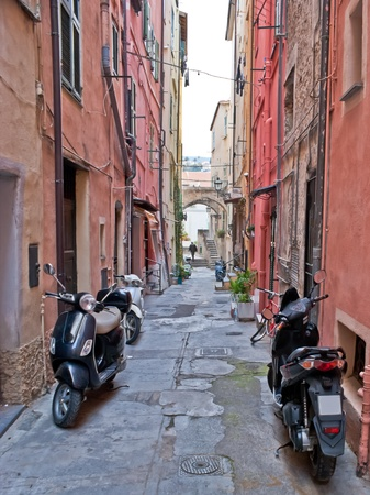 this street is narrow for public walking but not for parking of traditional italian transport, Sanremo, Italy