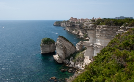 shores: you can see the winding haven of Bonifacio with its rocky shores and old genoese wall, Corsica