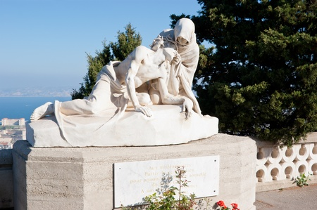 garde: The sculpture is situated in the front of Notre-Dame de la Garde, Marseille.