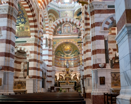 garde: The upper church of Notre-Dame de la Garde is richly decorated with multicolored marble and mosaics, Marseille, France Editorial