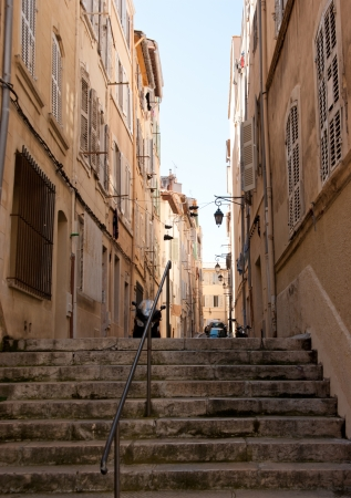 the centre of Marseille is full of people but the streets of the old city are empty and quiet photo