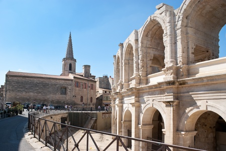 In ancient Arles the landmarks of roman period and medieval buildings are neighbours.
