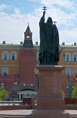 Moscow, Russia - June 28, 2013: The monument to Hieromartyr Hermogenes the Patriarch of Moscow and All Russia with the Middle Arsenalnaya Tower of Moscow Kremlin on the background.