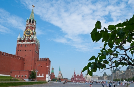 Moscow - June 28, 2013: The view on the Red Square with the Spasskaya Tower. This Tower (the Saviour Tower) or Frolovskaya Tower is the main tower of Moscow Kremlin. The clock of the tower top usually referred to as the Kremlin chimes and they designate o