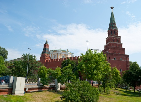 The Oruzheynaya (Armory) Tower and Borovitskaya Tower (with a star) of Moscow Kremlin from the Alexander Garden. photo