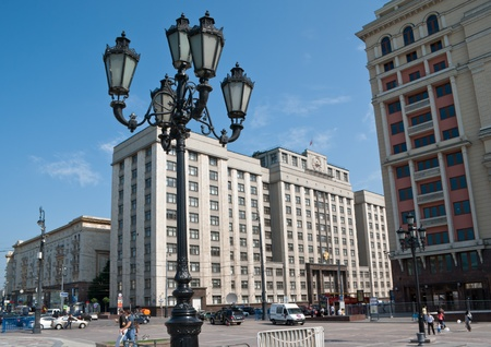 duma: Moscow - June 28, 2013: The old streetlight on Manege Square with Parliament of Russian Federation (The State Duma) on the background.