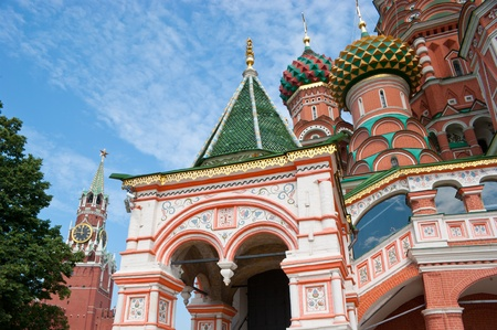 the entrance to the Saint Basil's Cathedral with the Spasskaya Tower of the Moscow Kremlin on the background photo
