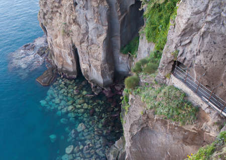 forbidding: the coastline of Sorrento is rocky and forbidding. Stock Photo