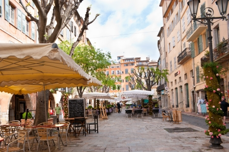 Grasse, France - May 8, 2013: Cozy cafes on a beautiful square on a Place aux Aires.