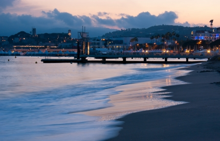 The sea in the evening illuminates by citylights, Cannes, France. photo