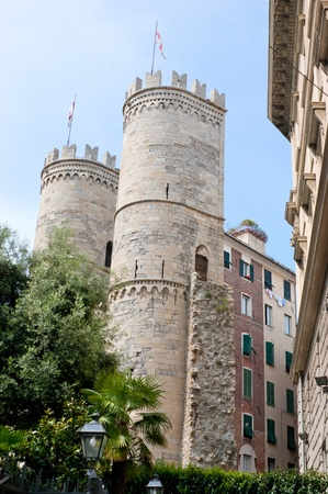 rampart: Two medieval towers were the parts of the Genoa rampart. Stock Photo