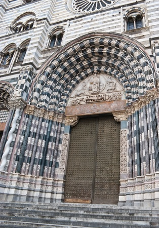 cattedrale: The entrance to the Cattedrale di San Lorenzo with sculptures and decorations around the door.