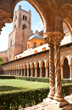 moresque: the view on the belltower of Monreale cathedral from the courtyard with great columns. Sicily Stock Photo
