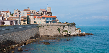 pablo picasso: The old town of Antibes with medieval tower of Grimaldi Castle, France. Stock Photo