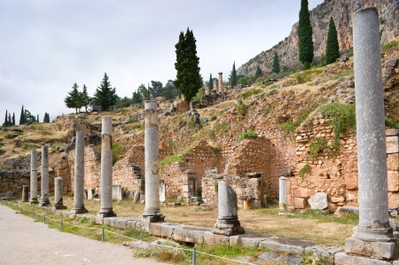 athenians: The ruined columns of Spartan monument in commemoration of the victory over the Athenians at Aegospotami, Delphi, Greece. Stock Photo