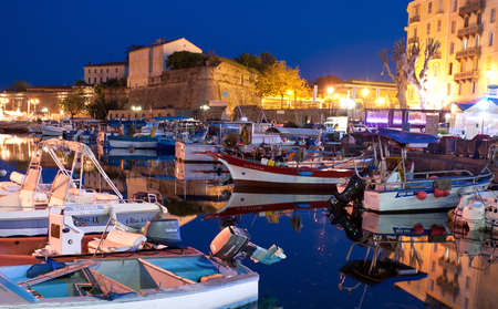 AJACCIO, FRANCE - MAY 2, 2013: The small fishing Port Tino Rossi with the old citadel , on May 2, 2013 in Ajaccio, Corsica. Zdjęcie Seryjne - 24645277