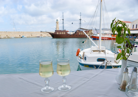The best place for romantic supper on Crete is the small cozy cafe in The Old Venetian Port with a view on medieval ship, Rethymno, Greece