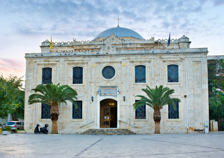 moresque: HERAKLION, GREECE - OCTOBER 13, 2013: The Ottoman Vezir Mosque, built on the site of the church of St Titus, and now the basilica of St Titus, on October 13 in Heraklion.