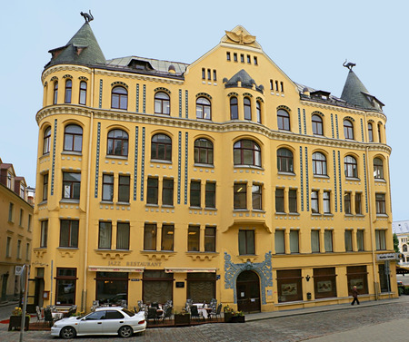 RIGA, LATVIA - SEPTEMBER 23, 2011:  The Cat House is styled as medieval architecture with some elements of Art Nouveau and located across the house of the Great Guild, on September 23 in Riga.