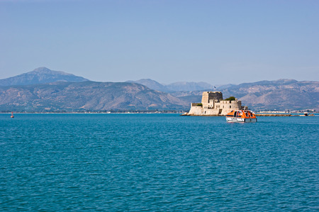 bourtzi: The Bourtzi Castle (Tower) is located in the middle of the harbour of Nafplio, Argolida, Greece. Editorial